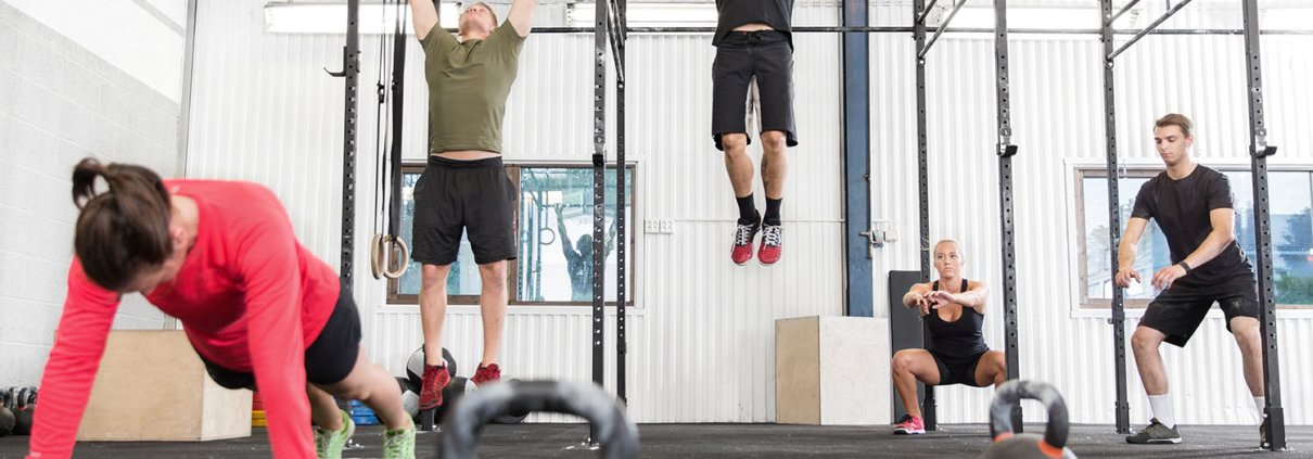 crossfit athletes performing exercises