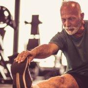 mature-man-stretching-athletic