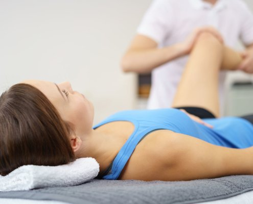 physical therapist stretching leg