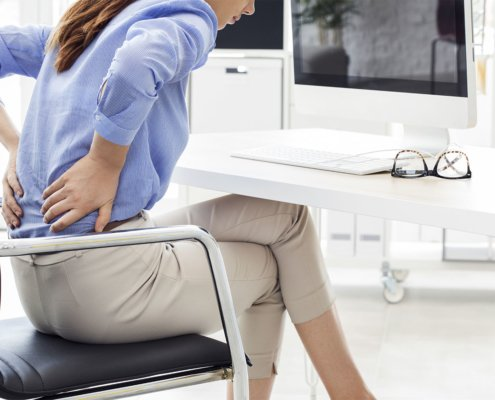 woman poor posture office chair