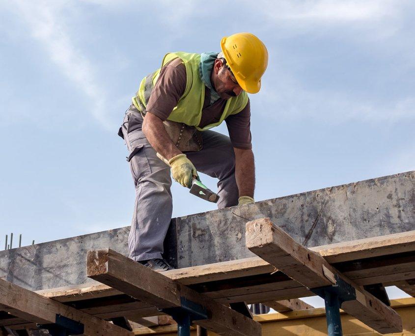 construction worker bending